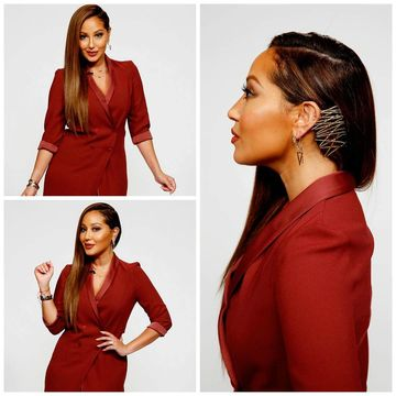 @AdrienneBailon is serving up fierce with this chic side 'do.